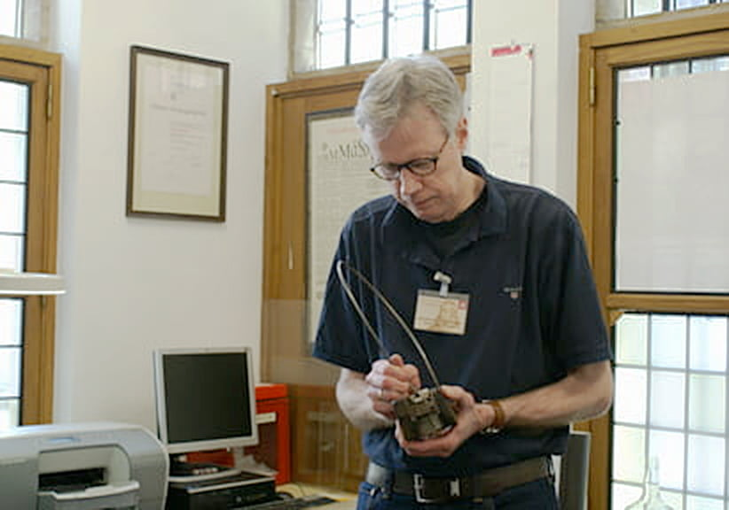 Frank E. Blokland with mould at the Museum Plantin-Moretus